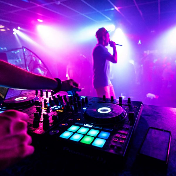 artist with a microphone performs on the stage of a nightclub at a party